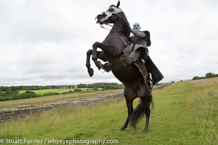 Model as the Night King on a rearing horse by Hadrian's Wall during a photo shoot to promote Game of Thrones Season Seven