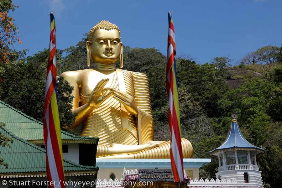 The enormous Golden Buddha statue at the Golden Temple at Dambulla, which is renowned for its UNESCO World Heritage Site designated cave temple,